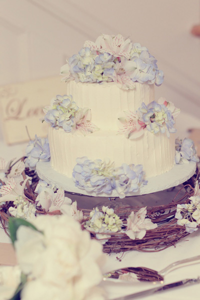 two tier wedding cake with fresh flowers