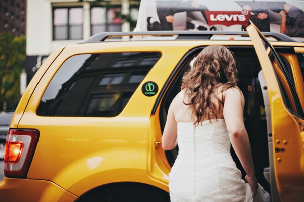 bride getting into New York taxi