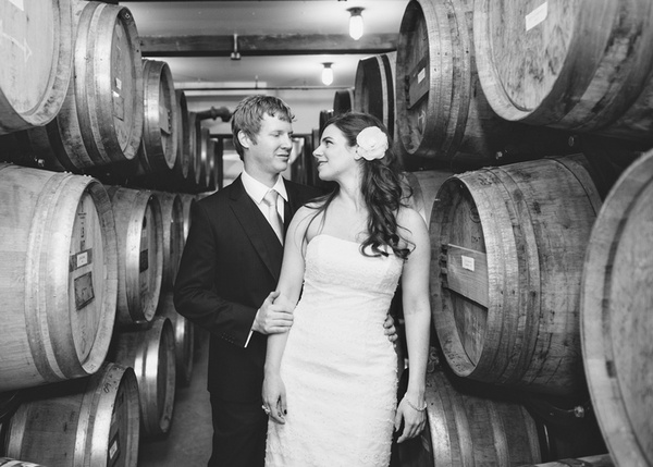 wedding portrait among wine barrels