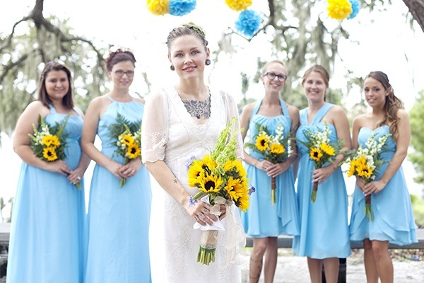 Blue bridesmaid dresses and sunflower bouquets