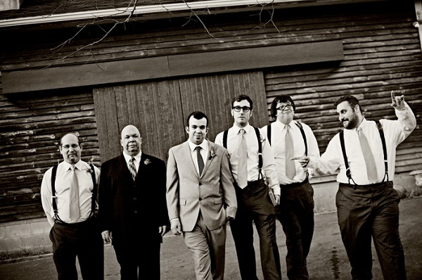 groomsmen portrait in front of barn