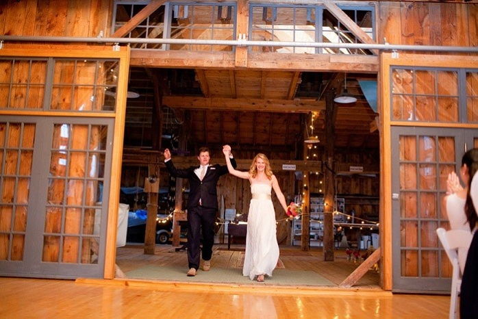 barn-wedding-couple-entrance-paige-paul
