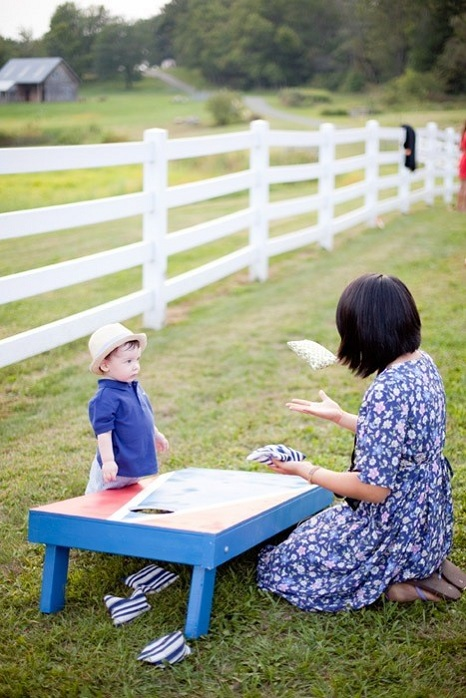 farm-wedding-guests-children-games-cornhole