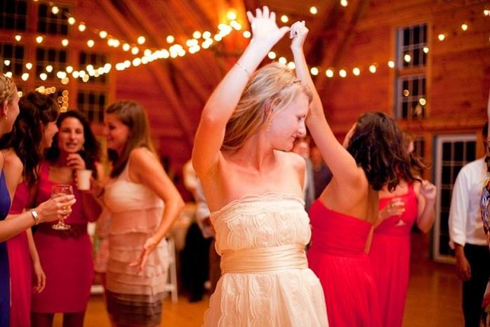 real-intimate-wedding-bride-dancing-with-guests-barn-wedding