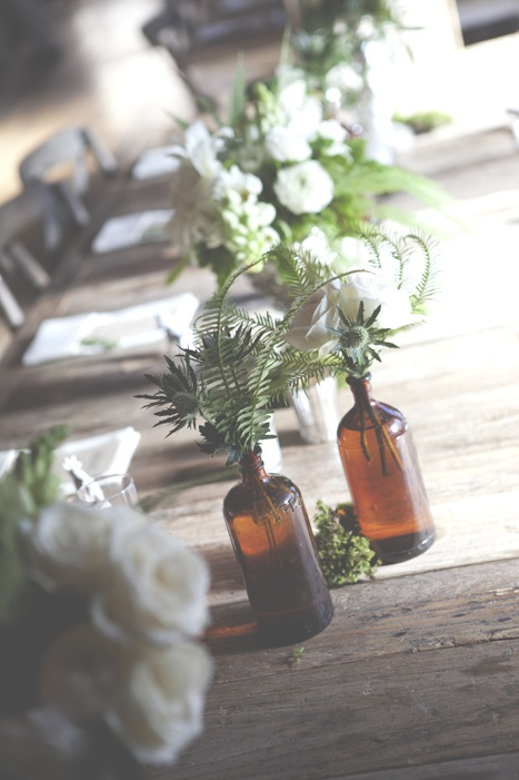intimate-wedding-reception-glass-bottles-centerpiece