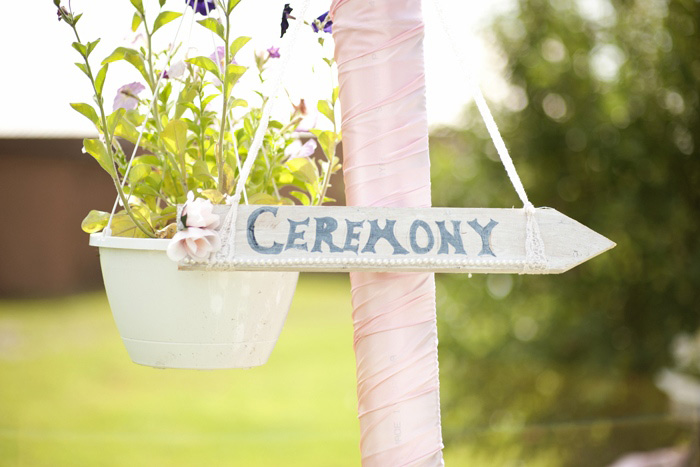 Wooden wedding ceremony sign