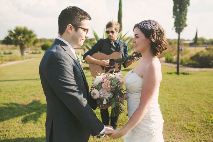 officiant playing the guitar during elopement ceremony