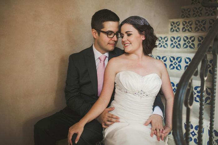 bride and groom on spanish tile steps