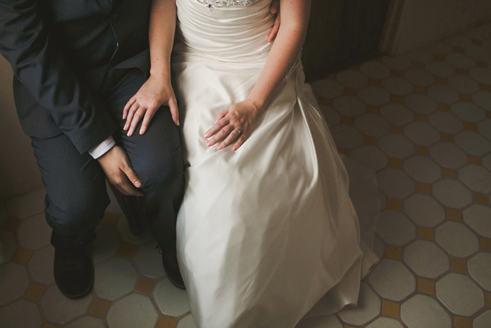 bride's hand on groom's knee