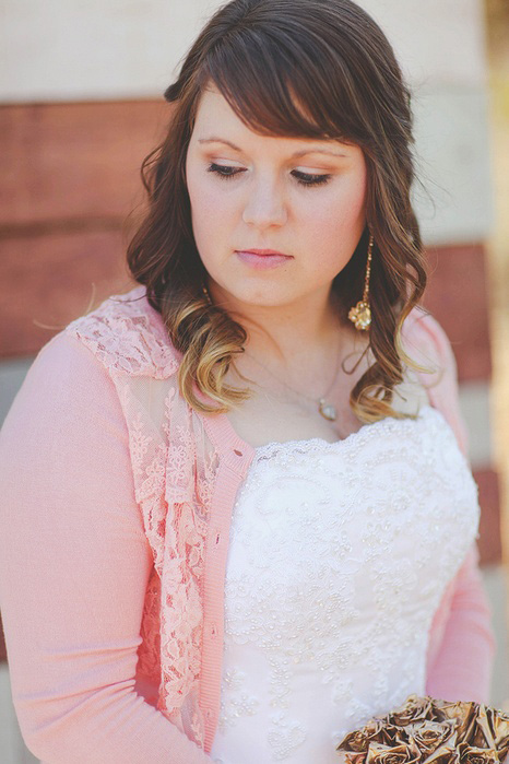 bride in pink cardigan