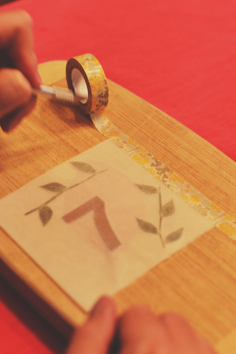 diy table numbers with waxed paper - tape panels together with washi tape