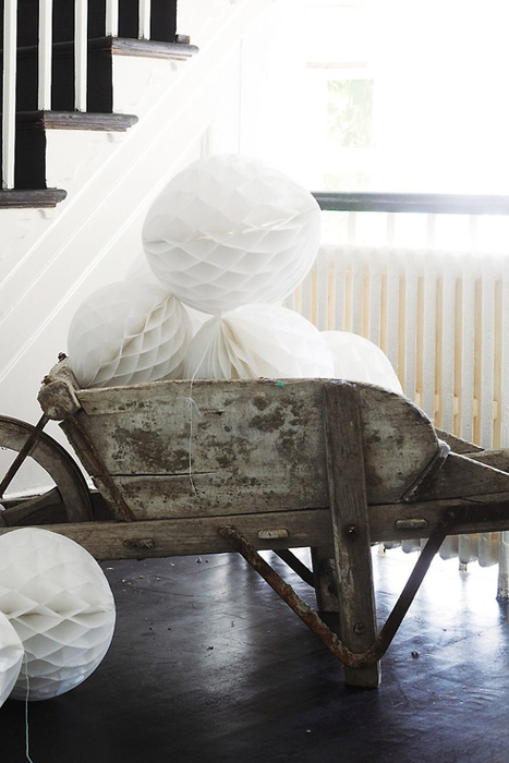 white honeycomb balls in a wheelbarrow