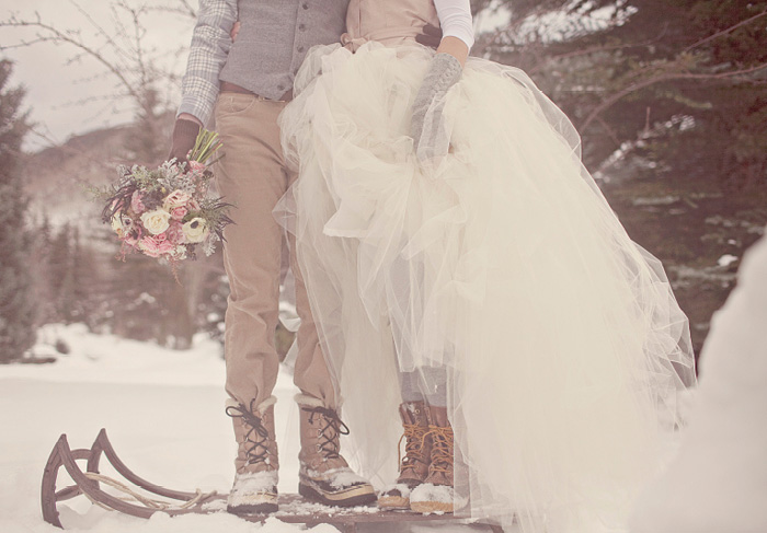 bride and groom in winter boots