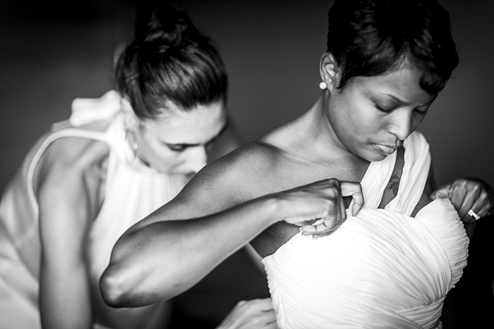 bride adjusting wedding dress