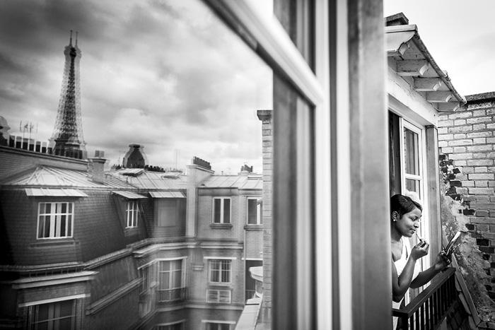 bride leaning out Paris wedding