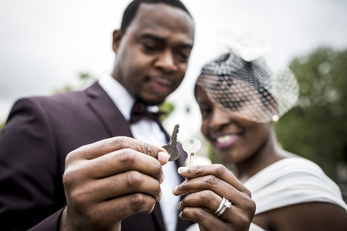 bride and groom with lock keys