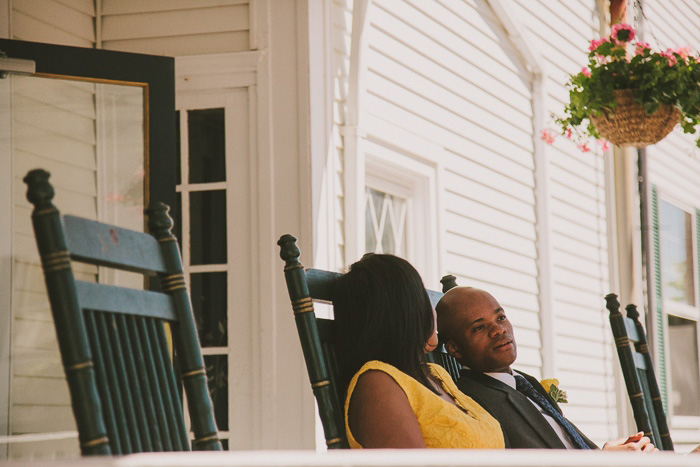 bride and groom on the porch of the emerson inn