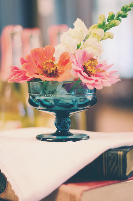 pink flowers in blue glass vase