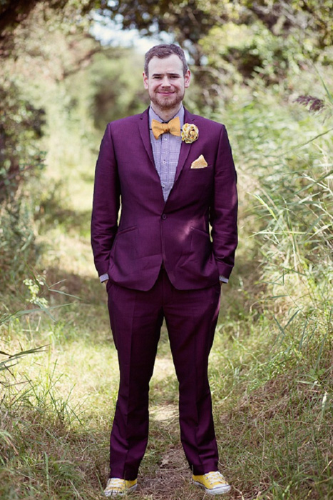 purple suit and yellow bow tie