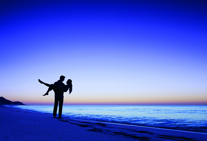 couple on the beach at dusk