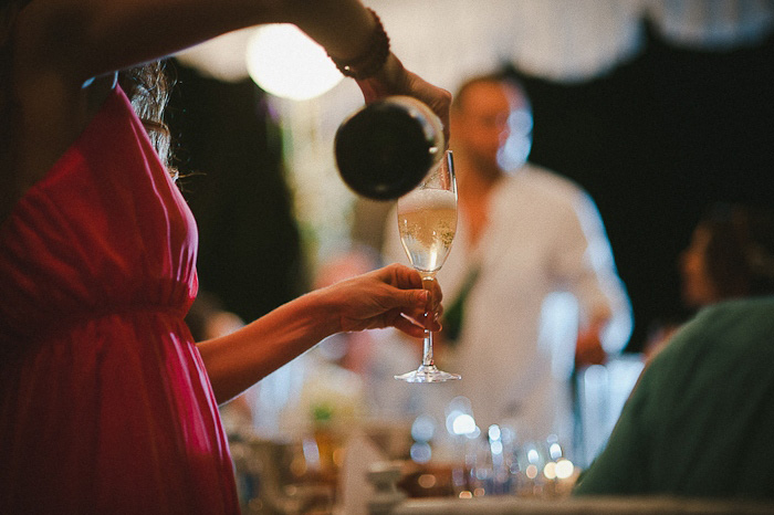 wedding guest pouring champagne