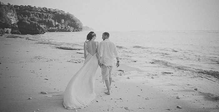 bride and groom walking on the beach in Bali