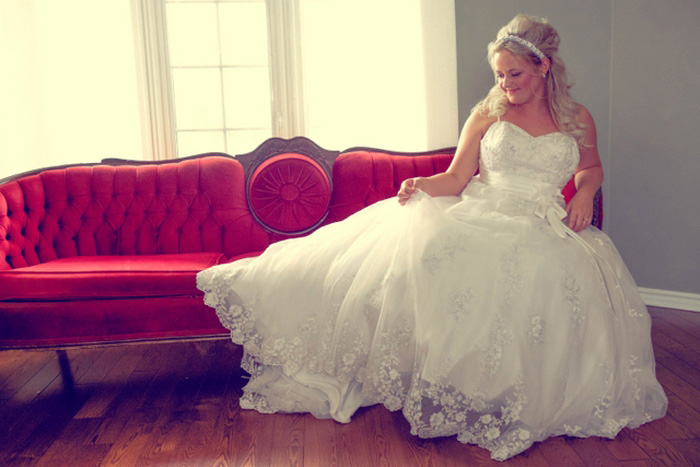 bride on red chaise lounge