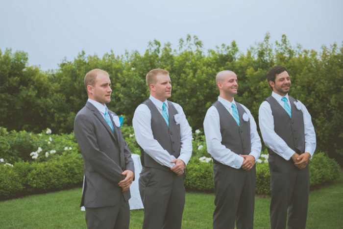 groomsmen at the altar