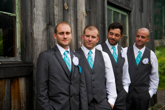 groomsmen in front of barn