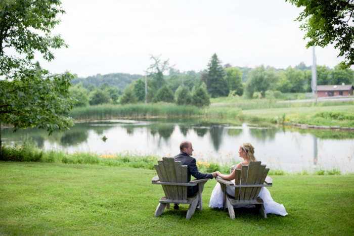 bride and groom in muskoka chairs