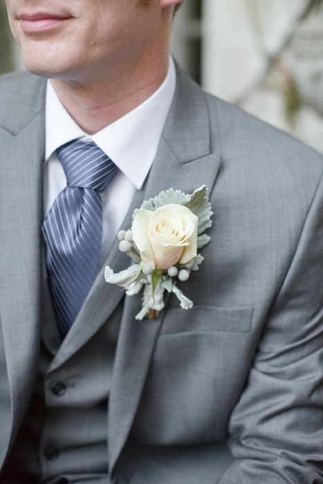 groom with white rose boutonniere