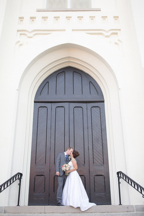 wedding portrait in front of church doors
