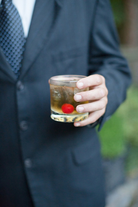 wedding guest with cocktail