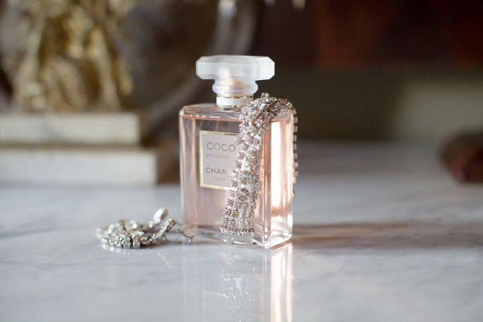 Chanel perfume bottle with crystal aerrings
