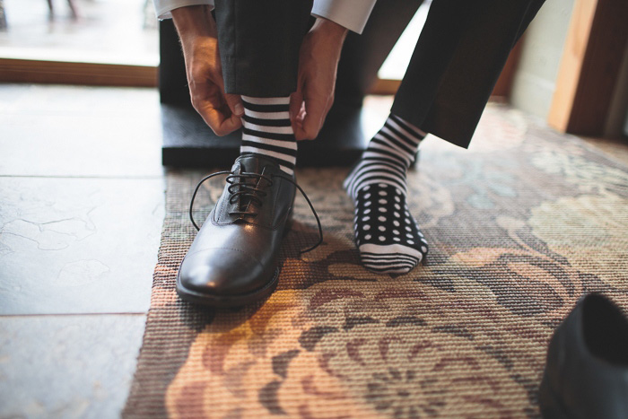 groom in striped socks