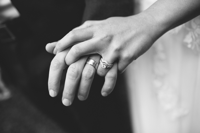 bride and groom with their wedding rings