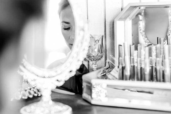 Bride doing her make-up
