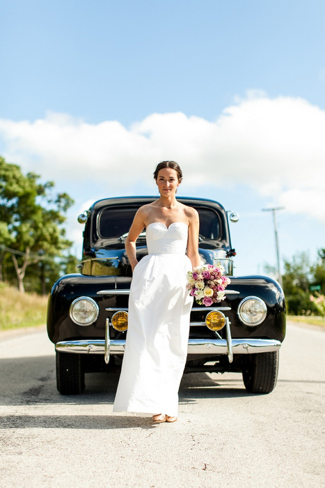 bride in front of vintage car