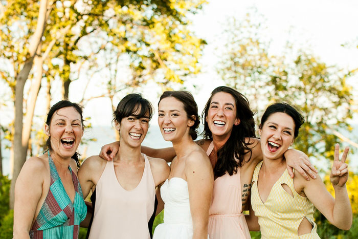 bride with her sisters