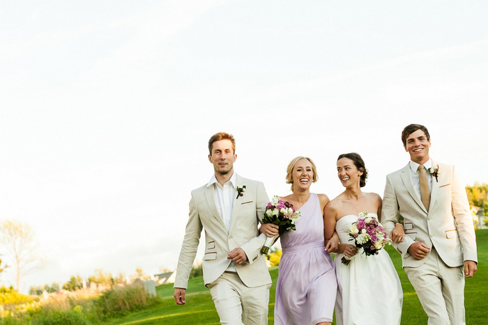 bridal party walking across golf course
