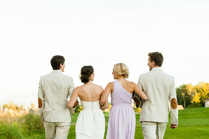 wedding party walking arm in arm