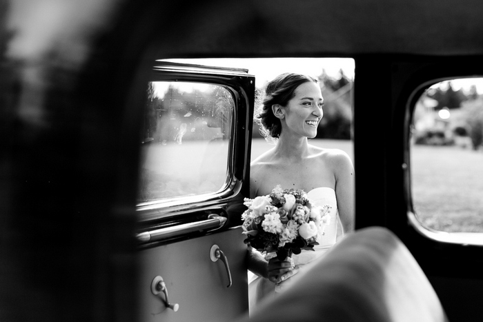 bride getting into vintage car
