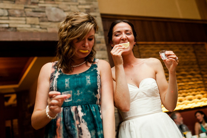 bride and guest doing shots