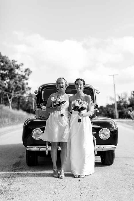 bridal party in front of vintage car