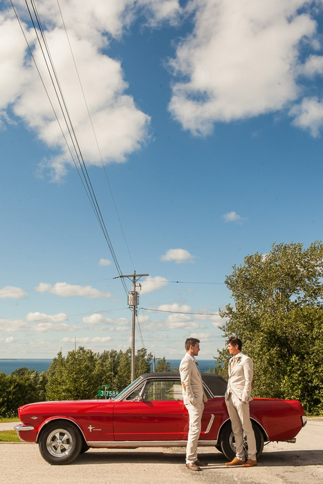 groom and best man with red convertible mustang
