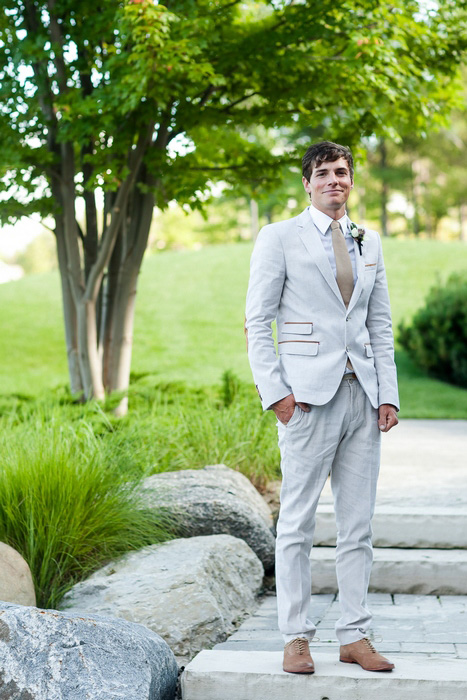 groom in pale suit