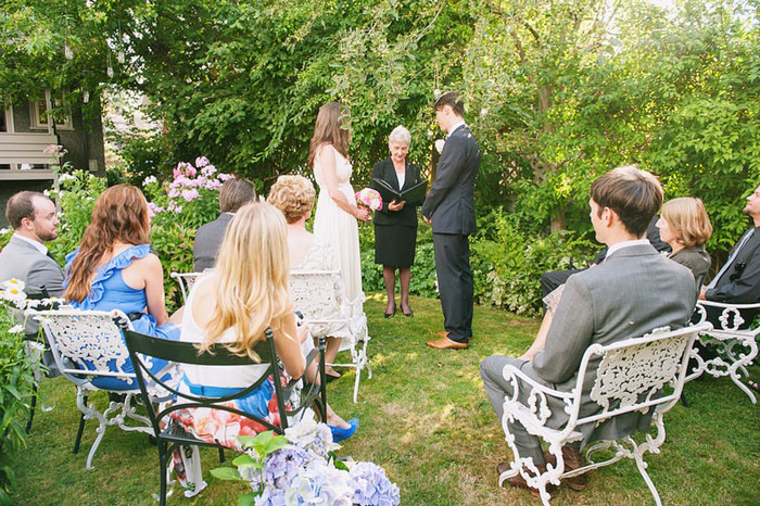 bride and groom at the backyard altar