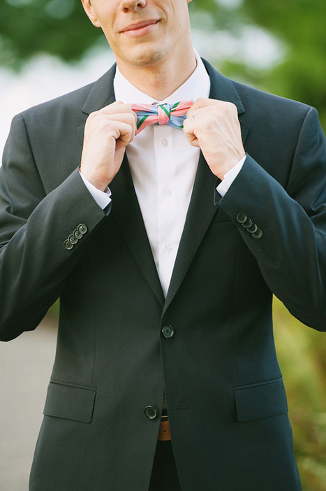 groom in colorful bow tie