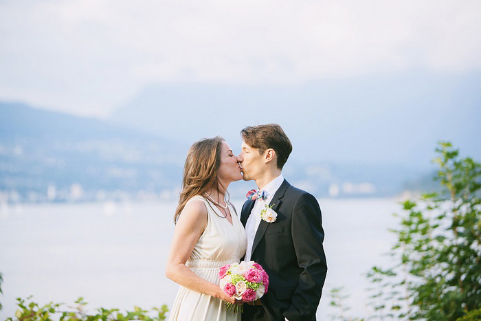 bride and groom kissing my the sea