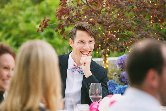 groom at intimate wedding reception